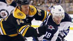 Boston Bruins' Joe Corvo (14) gets an interference call while defending Winnipeg Jets' Bryan Little (18) in the first period of an NHL hockey game in Boston, Saturday, Nov. 26, 2011. (AP Photo/Michael Dwyer)
