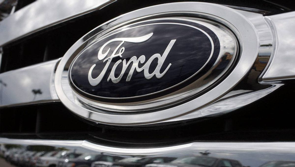 In this June 28, 2009 file photo, a long line of F-150 pickup trucks is reflected in the grille of another F-150 at a Ford dealership in Centennial, Colo.
