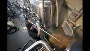Bellwoods Brewery co-owner Mike Clark removes the spent grain from the Mash Tun brewing vessel at the newly opened micro brewery in Toronto, Ont. Thursday, April 12/2012. (Photo by Kevin Van Paassen/The Globe and Mail)