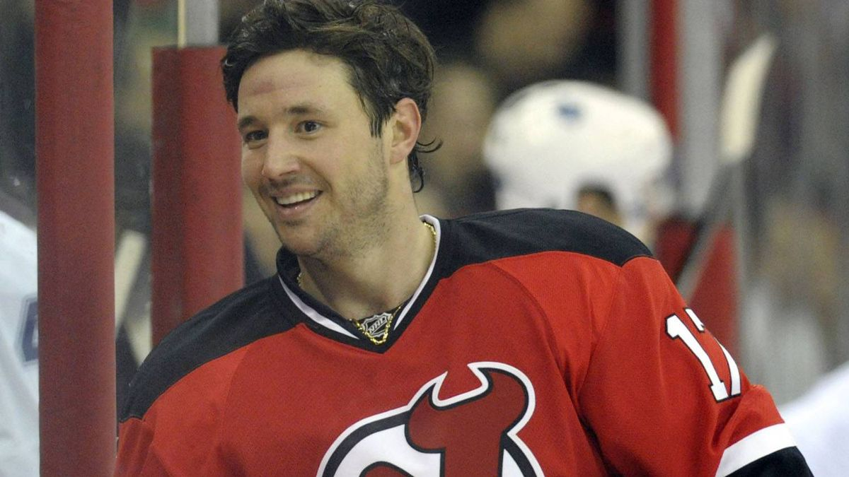 New Jersey Devils left wing Ilya Kovalchuk grins as he comes to the bench after the Devils scored against the Toronto Maple Leafs in the first period of their NHL hockey game in Newark, New Jersey, February 5, 2010. REUTERS/Ray Stubblebine