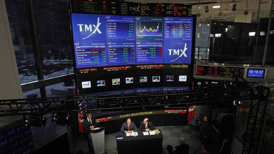 London Stock Exchange CEO Xavier Rolet, left, and TMX Group CEO Tom Kloet speak to the media at the TMX Broadcast centre.