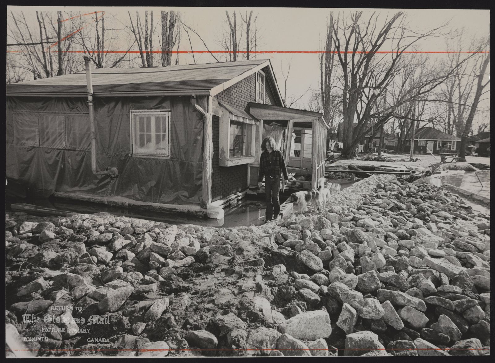 LAKE LEVELS (Just a few weeks ago the waters of Lake Ontario were lapping at Paul Saltzman's Channel Street home on Ward's Island, then creeping under the building as lake levels rose. Since then the city has poured tons of rock into the lake to protect the Channel Street homes.
