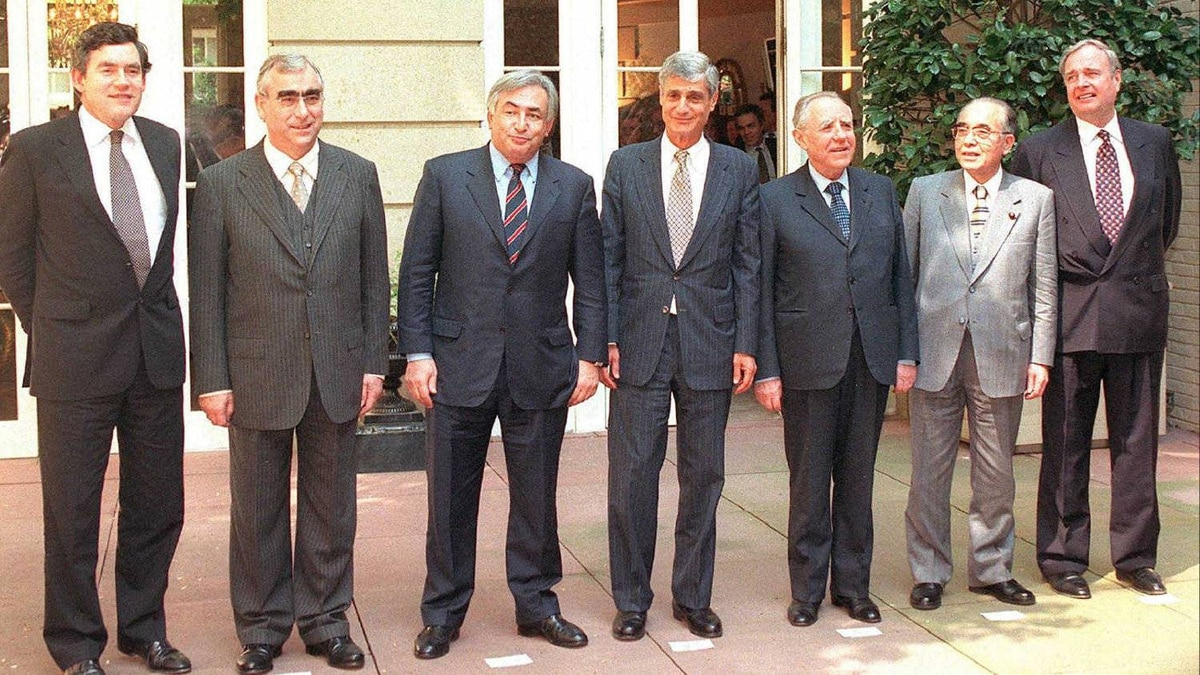 US Treasury Secretary Robert Rubin(C) poses for a group photograph April 15, 1998, with (L-R) Gordon Brown, Chancellor of the Exchequer of the United Kingdom, Theo Waigel, German Minister of Finance, Dominique Strauss-Kahn, French Minister of Economy and Finance, Rubin, Carlo Ciampi, Italian Minister of the Treasury, Hikaru Matsunaga, Japanese Minister of Finance, and Paul Martin, Canadian Minister of Finance at Blair House in Washington, DC. The meeting takes place before the start of meetings of the finance minister and bank governors from the Group of Seven (G-7) industrial nations.