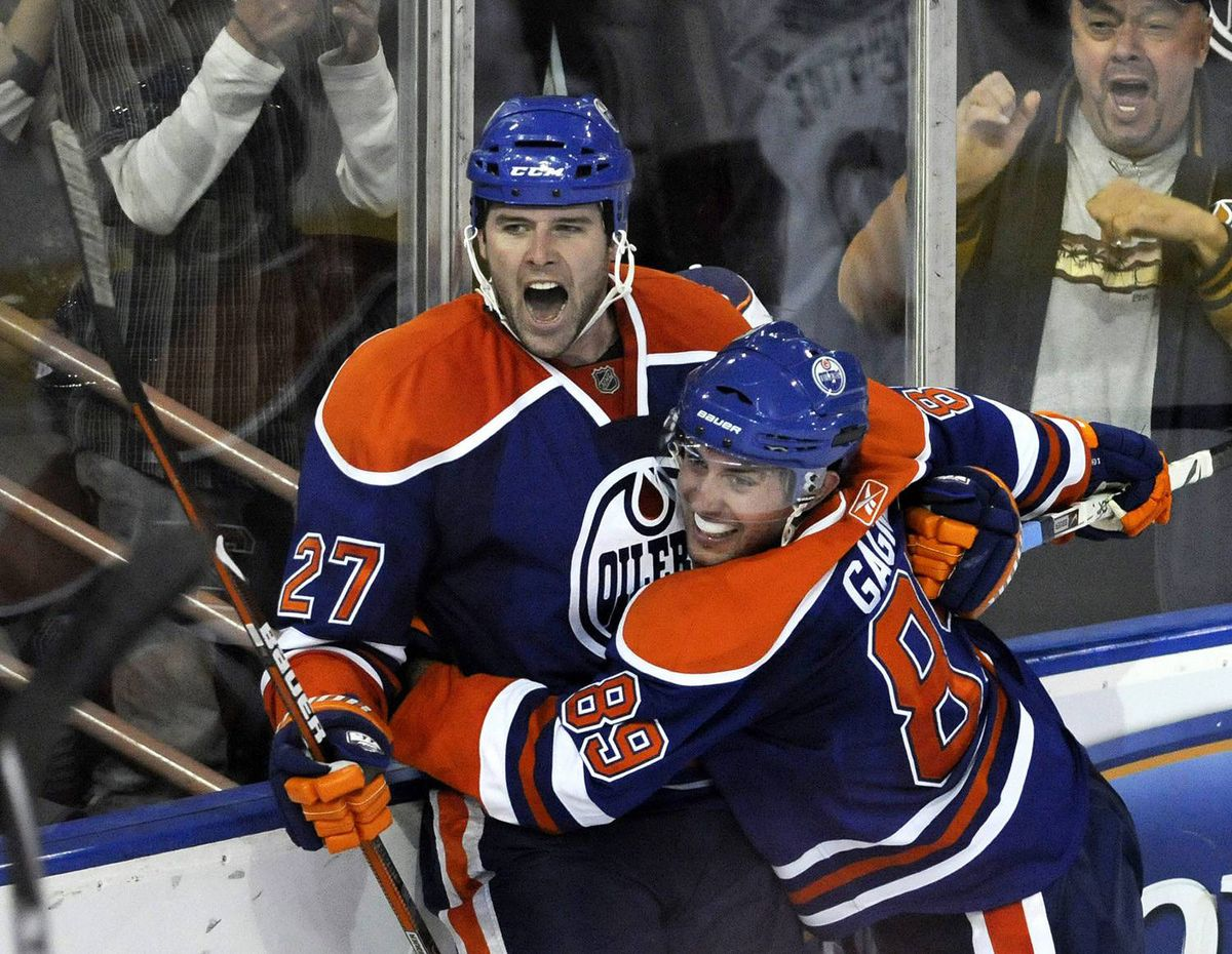 Edmonton Oilers' Dustin Penner, left, and Sam Gagner celebrate a goal against the Columbus Blue Jackets during the third period of their NHL hockey game in Edmonton October 22, 2009.