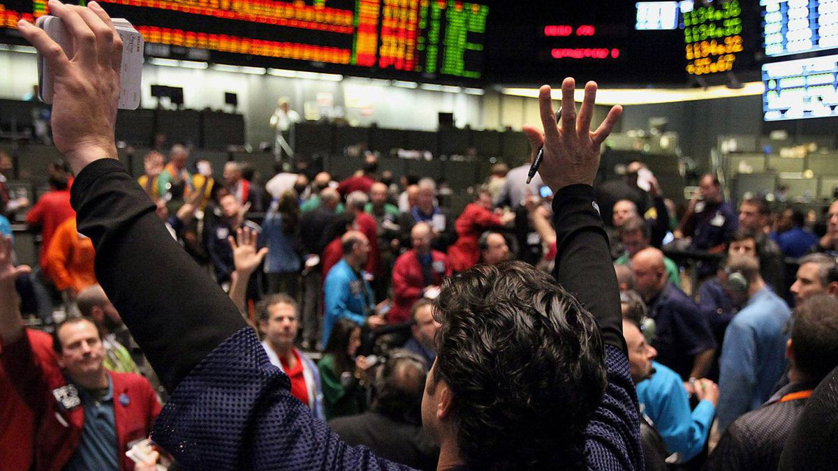 Traders work at the Chicago Board of Trade in Chicago on Monday, Nov. 28. Global stocks rose for the first time in 11 days and commodities and the euro advanced as European leaders drafted a framework for the region's bailout fund.