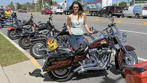 Jessica Phillips with a 2007 Harley Davidson Road King (1,586 cc, six-speed