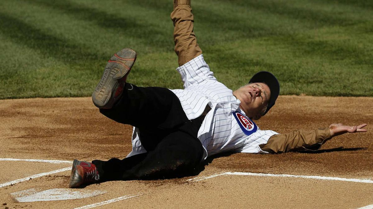 And here is Bill Murray sliding into home after rounding the bases before throwing out the ceremonial first pitch at the Chicago Cubs' opening-day game against the Washington Nationals last week in Chicago. The Nationals won 2-1.