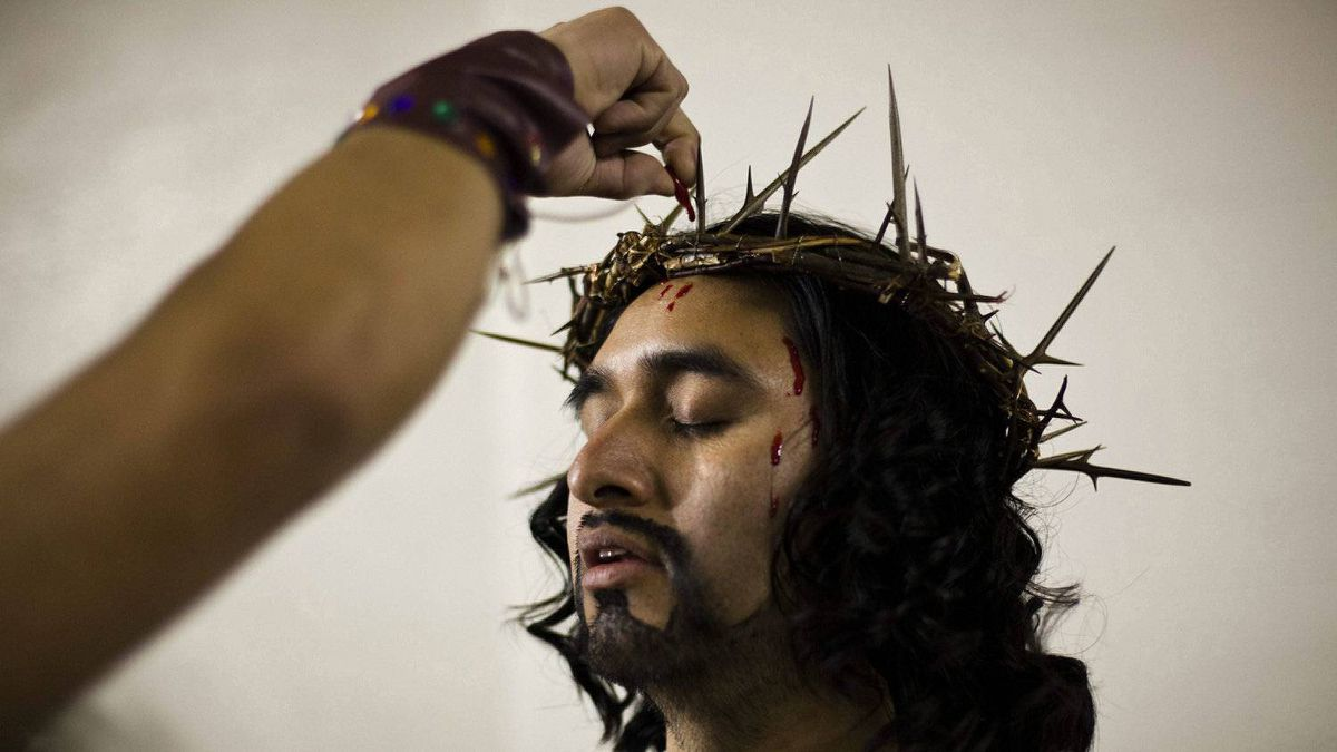 Abel Martinez, portraying Jesus, has fake blood applied to his head in the basement of the Annunciation Of The Blessed Virgin Mary Catholic Church before he and other parishioners conduct a Good Friday procession to commemorate the Stations of the Cross, Friday, April 6, 2012, in south Philadelphia.