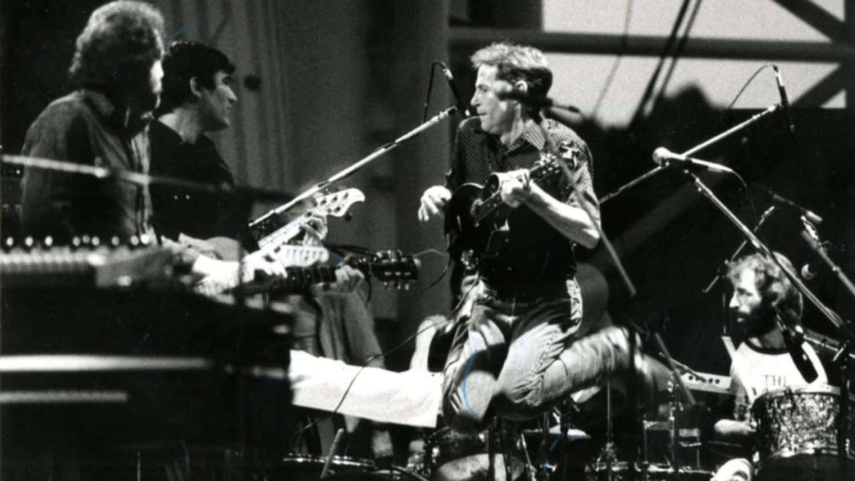 Levon Helm jumps into the air while Richard Manuel fills in on the drums during a 1983 Band reunion concert that didn't include guitarist Robbie Robertson.
