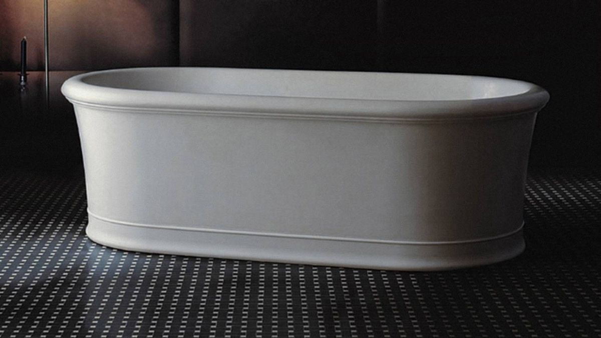 A WELCOME MATTE Emma DADOquartz tub, $5,500 through www.camltomlin.com.