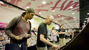 Customer Roger Oegema is helped by HMV assistant manager, Jerry Medeiros in a Toronto HMV outlet.
