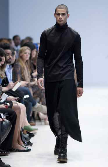 Shrouded in a mostly black palette, Toronto's Sid Neigum focused predomintely on men's wear this season. Hard-edged leather, a Neigum favourite, stood against draped tops, skirts and dresses over slim trousers for a decidedly unisexy feel.