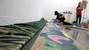 Yunhee Min(left) and Sam Morgan(right) work on part of the art project.