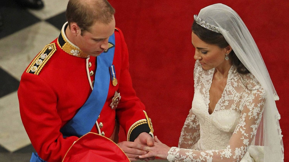 """""""With this ring, I thee wed."""" Prince William places a ring on Kate Middleton's finger before the Archbishop of Canterbury (and tens of millions of viewers) during their wedding ceremony in Westminster Abbey on April 29, 2011."""