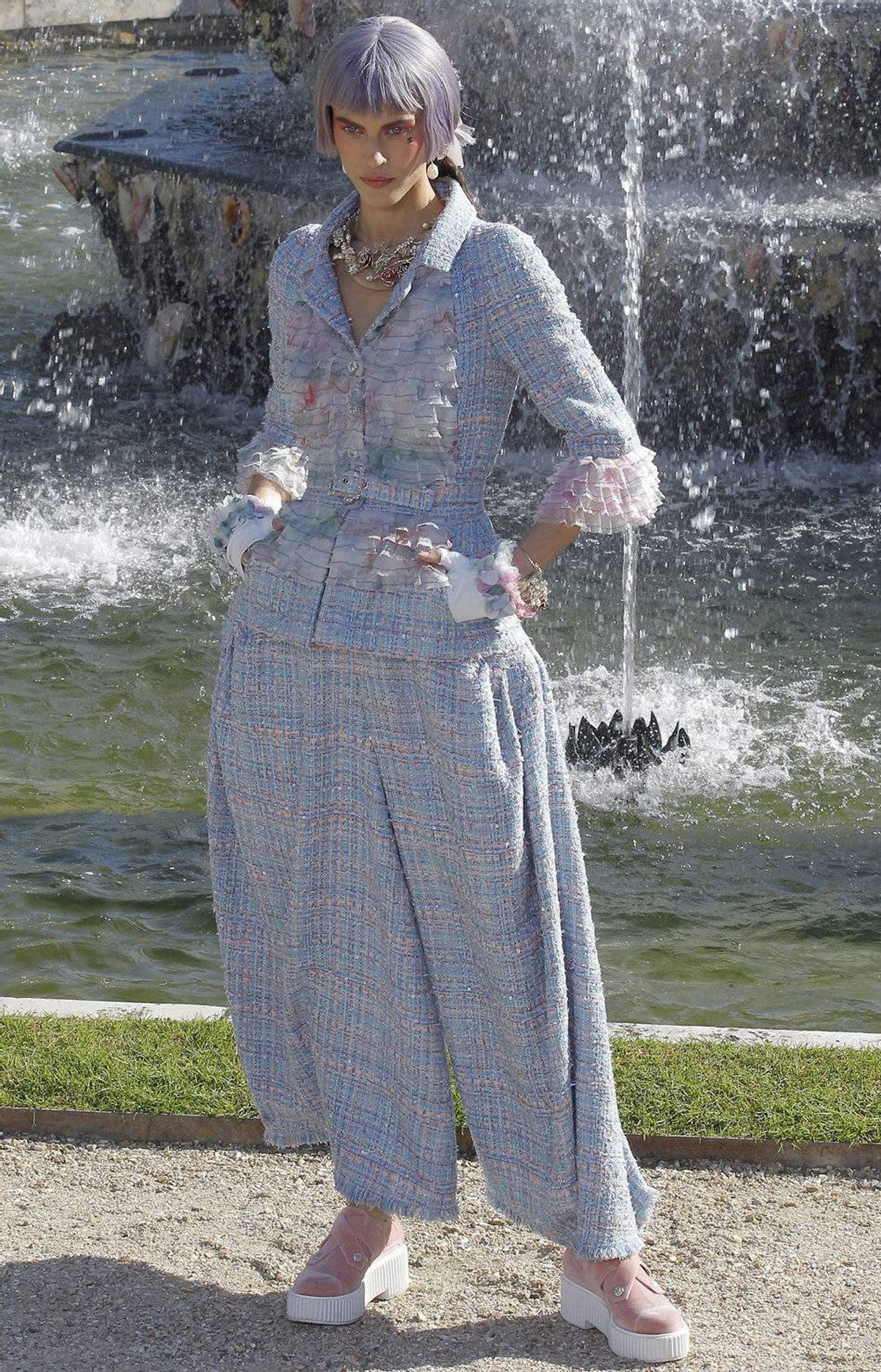 Only at Chanel could tweed palazzo pants exist without irony. Ditto the candy-coloured bobs over ponytail hair – a nod to the powdered wigs from the 18th century (and perhaps a more tasteful take on today's rainbow-coiffed stars Nicki Minaj and Katy Perry).