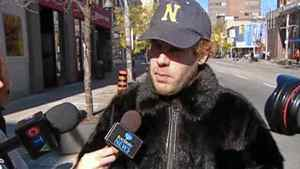 """World-renowned Cape Breton fiddler Ashley MacIsaac confronted PETA protesters in downtown Windsor, Ont., on Friday afternoon. MacIsaac arrived at an anti-fur demonstration alone, unannounced and wearing a muskrat fur coat. He was also carrying a handmade sign reading """"I support the Canadian Seal Hunt."""""""