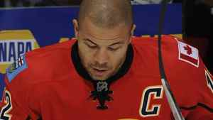 Jarome Iginla #12 of the Calgary Flames knocks the pucks down at the start of warm up before his game against the St Louis Blues on October 28, 2011 at the Scotiabank Saddledome in Calgary, Alberta, Canada. (Photo by Dale MacMillan/Getty Images)