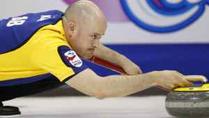 Alberta skip Kevin Koe delivers a shot as they play Quebec at the Brier curling championships in Halifax, Nova Scotia, March 10, 2010. REUTERS/Shaun Best