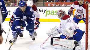 Montreal Canadiens goalie Carey Price (R) makes a save on Toronto Maple Leafs' Joey Crabb in the second period of their NHL hockey game in Toronto January 21, 2012.