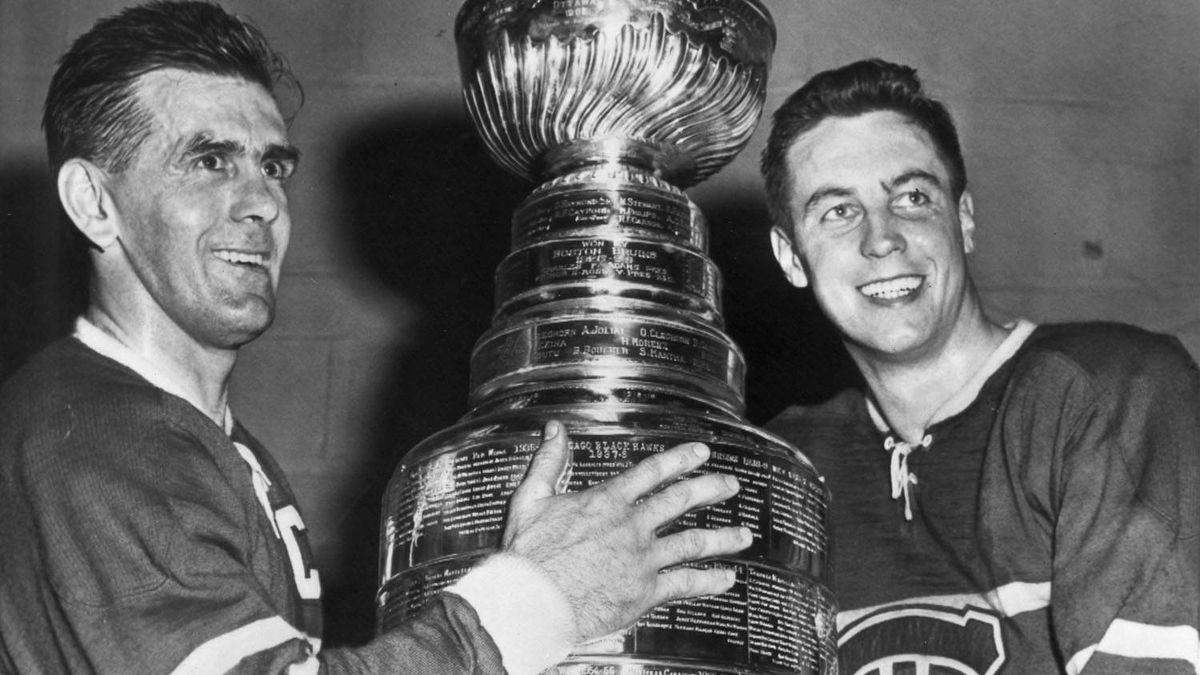 Maurice (The Rocket) Richard (left) and Jean (Le Gros Bill) Beliveau pose with the Stanley Cup after beating the Bruins to win NHL championship in Boston, Apr.20, 1958. Born as a French-Canadian team on Dec. 4, 1909, the Montreal Canadiens became the most famous and successful team in hockey, winning 24 Stanley Cups in their first 100 years. Most of those came in a glorious period from 1955 to 1979, when legends like Rocket Richard, Jean Beliveau and Guy Lafleur took the sport to unprecedented highs in artistry and victories. THE CANADIAN PRESS/AP files