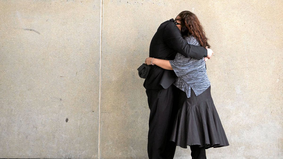 Tara McDonald, mother of slain eight-year-old Victoria Stafford, hugs partner James Goris during a break in court proceedings at the trial for Michael Rafferty, the accused in her daughter's murder.