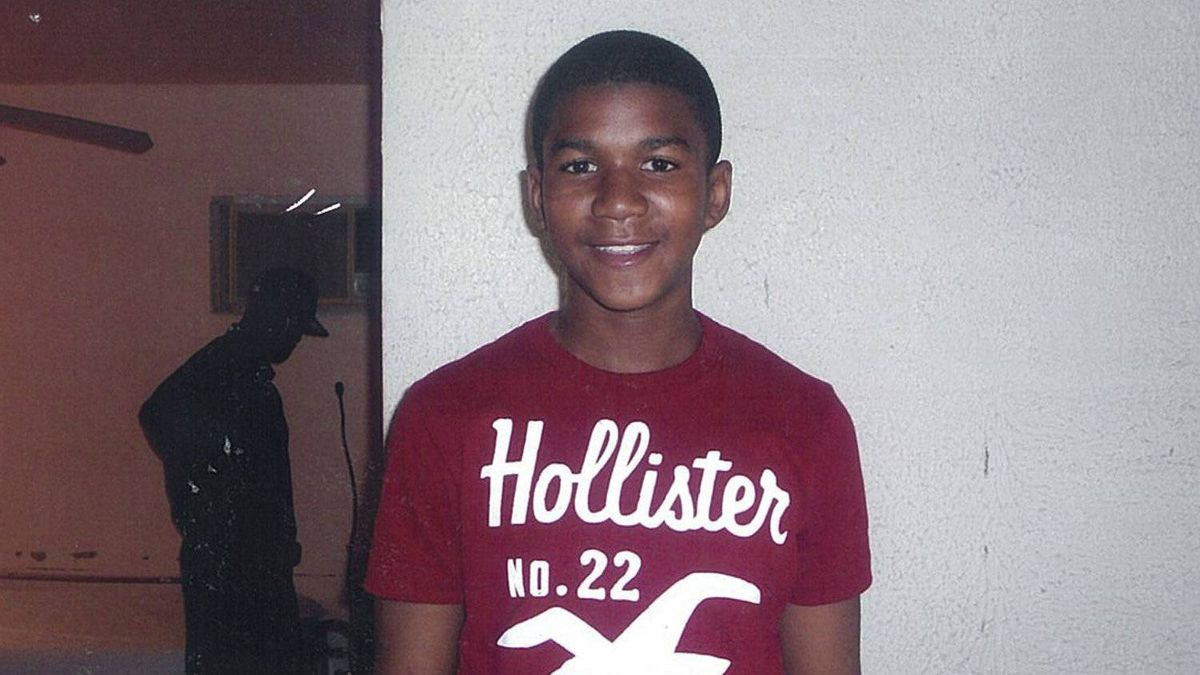 In this undated family photo, Trayvon Martin poses for a family photo. The family of the black teenager fatally shot by a white neighborhood watch volunteer arrived at Sanford City Hall Friday evening March 16, 2012 to listen to recordings of 911 calls police previously refused to release.