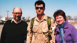 Brian Kells is pictured with father Peter Kells and mother Marlene Grace at the Ottawa Airport on April 16, 2009 - the day he returned from Afghanistan.