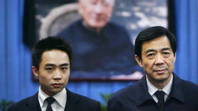 China's former Chongqing Municipality Communist Party Secretary Bo Xilai (R) and his son Bo Guagua stand in front of a picture of his father Bo Yibo, former vice-chairman of the Central Advisory Commission of the Communist Party of China, at a mourning hall in Beijing in this January 18, 2007 file photo.