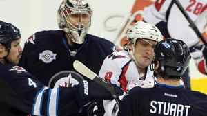 Alex Ovechkin #8 of the Washington Capitals shoves Mark Stuart #5 of the Winnipeg Jets as teammate Zach Bogosian #4 tries to stop him in NHL action at the MTS Centre on November 17, 2011 in Winnipeg, Manitoba, Canada. (Photo by Marianne Helm/Getty Images)