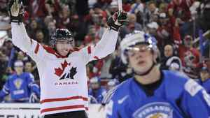 Canada's Ryan Strome (L) celebrates a goal as Finland's Miro Aaltonen reacts during the third period period of play at the 2012 IIHF U20 World Junior Hockey Championships in Edmonton, Alberta, December 26, 2011. REUTERS/Todd Korol