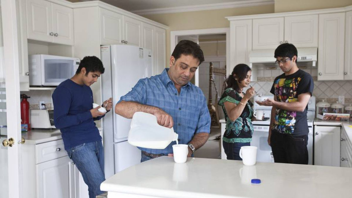 Yatin Shah (centre right), his wife Beena and sons Rocky, (centre left), and Sunny photographed in the family's Surrey home August 21st, 2009. The family will pay approximately $560 more per month on their expenses under the HST.