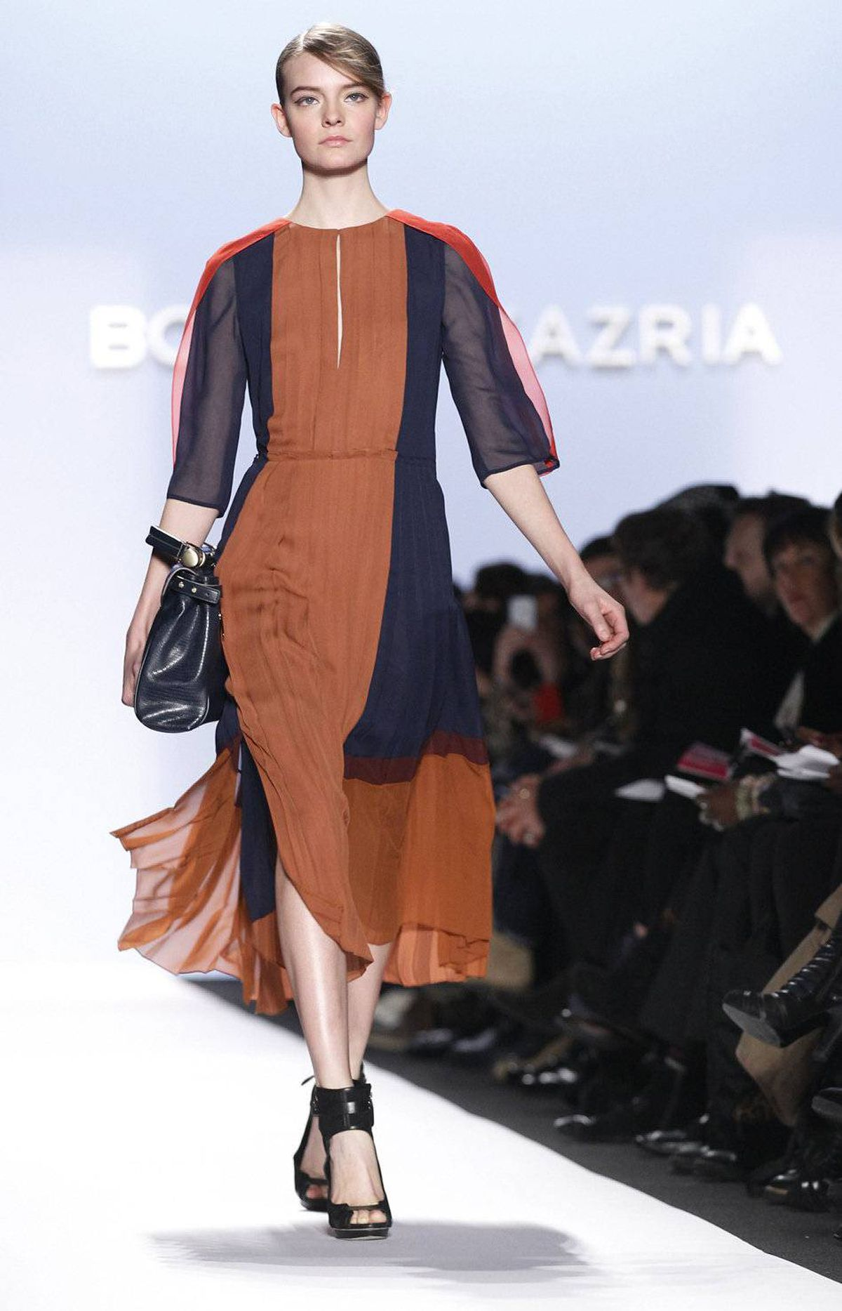 For Fall 2012, BCBG presented a collection inspired by the architectural aesthetic of Bauhaus style. Going from the functional, linear ideas espoused by Walter Gropius to these floaty, pleated dresses may be a bit of a stretch; but the colour-blocked palette is certainly borrowed from painter Josef Albers.