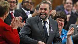 Thomas Mulcair receives a standing ovation as he rises for the first time as NDP Leader during Question Period in the House of Commons on March 26, 2012.