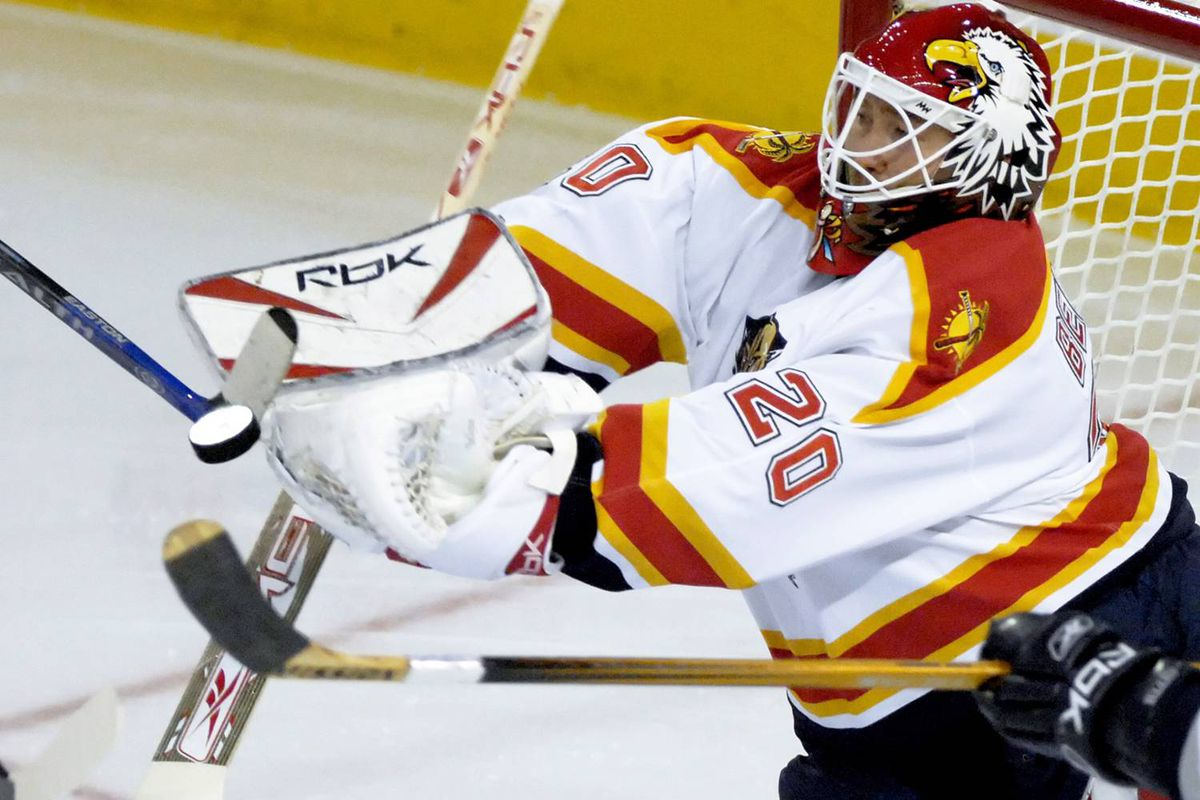 Florida Panthers goalie Ed Belfour reaches for the puck during a 2007 NHL game in Edmonton. Belfour has been hired by the St. Louis Blues to work as a goaltending consultant.