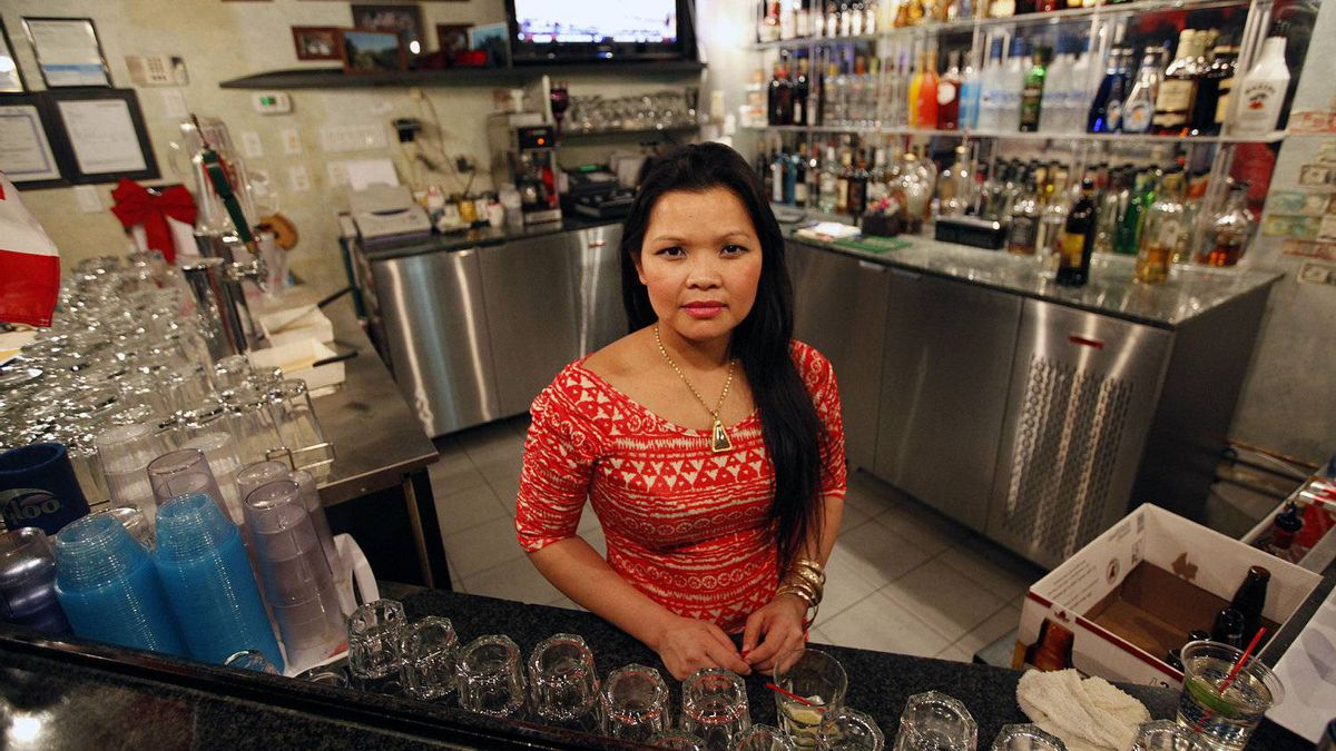 Kay Phouttharath, manager of K's Sports Lounge and Grill in London on Feb. 8, 2012. She has seen a significant decrease in customers since Electro-Motive's workers were locked out and is very upset the government is doing nothing to help.