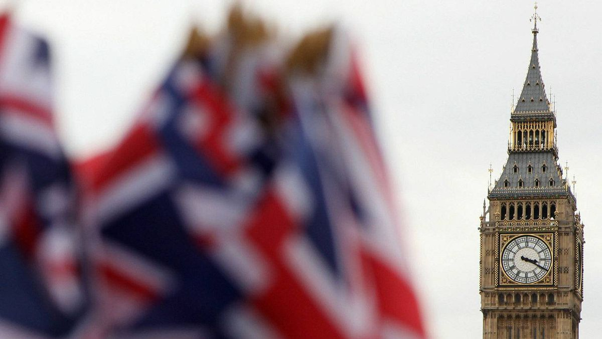 Union flags are on sale in front of the Houses of Parliament on October 22, 2010 in London, England. Tickets and souvenirs won't come cheap at the London 2012 Summer Games. (Photo by Oli Scarff/Getty Images)