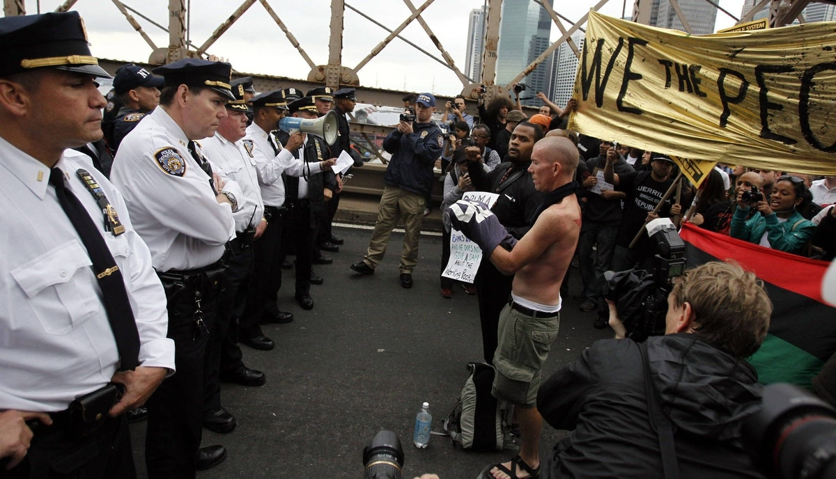 Police square off against protesters on the Brooklyn Bridge during an Occupy Wall Street march in New York October 1, 2011.