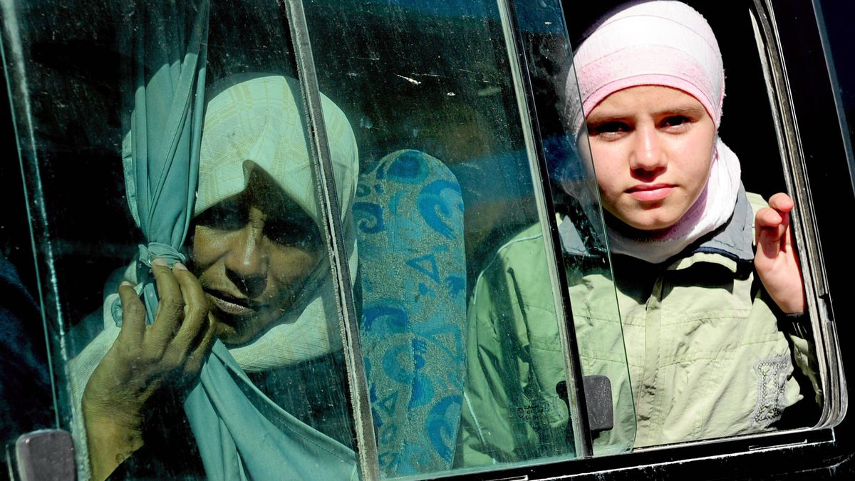Syrian refugees who fled from Syria to Turkey leave the Yayladagi Turkish Red Crescent refugee camp by bus, near the Turkish city of Hatay, on June 8, 2011.