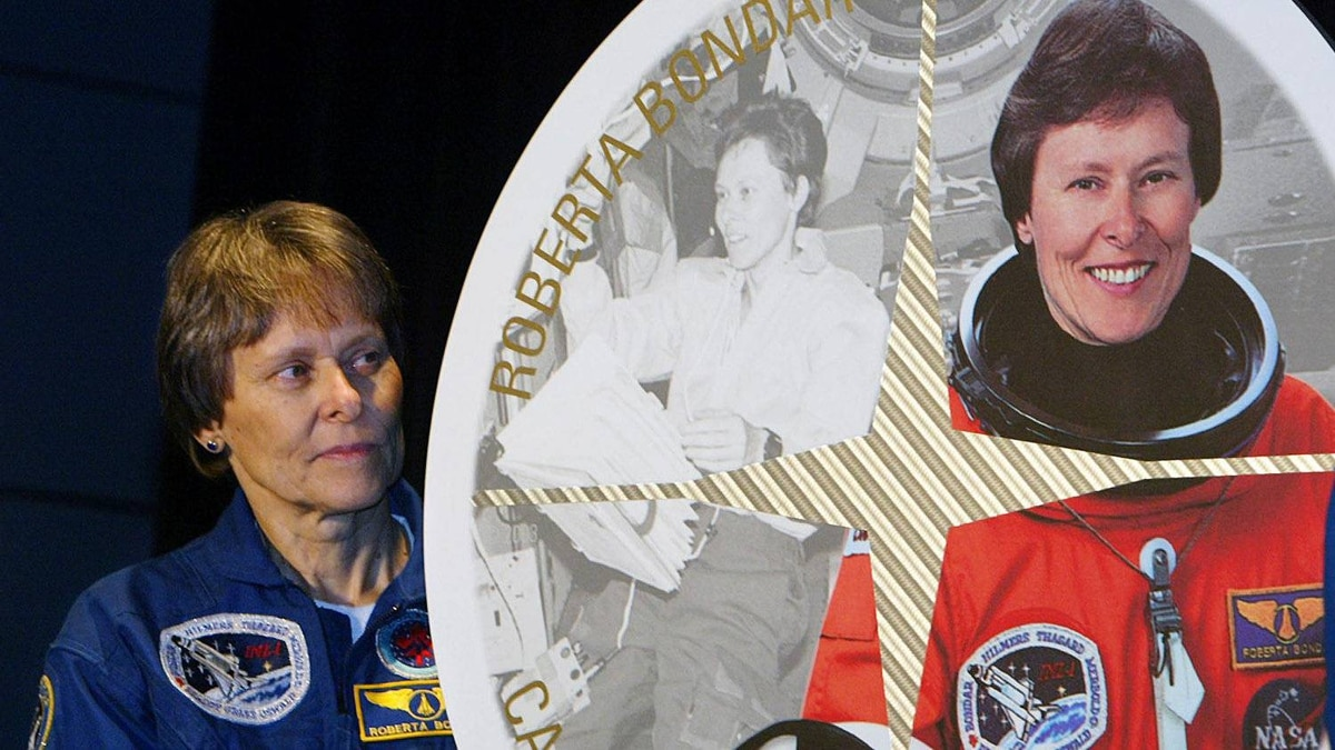 Astronaut Roberta Bondar stands beside a stamp featuring her likeness at the John H. Chapman Space Centre in St-Hubert, Que., on Friday, Sept. 26, 2003.