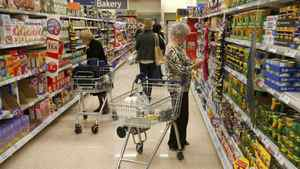 Customers shop for groceries in a supermarket in London October 18, 2011. Inflation in Britain hit a three-year high in September driven by soaring gas and electricity bills, further eroding living standards and piling more pressure on the government to help struggling consumers.