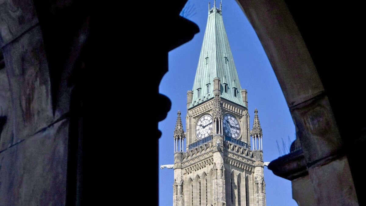 The Peace Tower is framed by an archway on the East Block of Parliament in September of 2009.