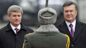 Prime Minister Stephen Harper and Ukrainian President Viktor Yanukovych inspect troops during a welcoming ceremony in Kiev on Oct. 25, 2010.