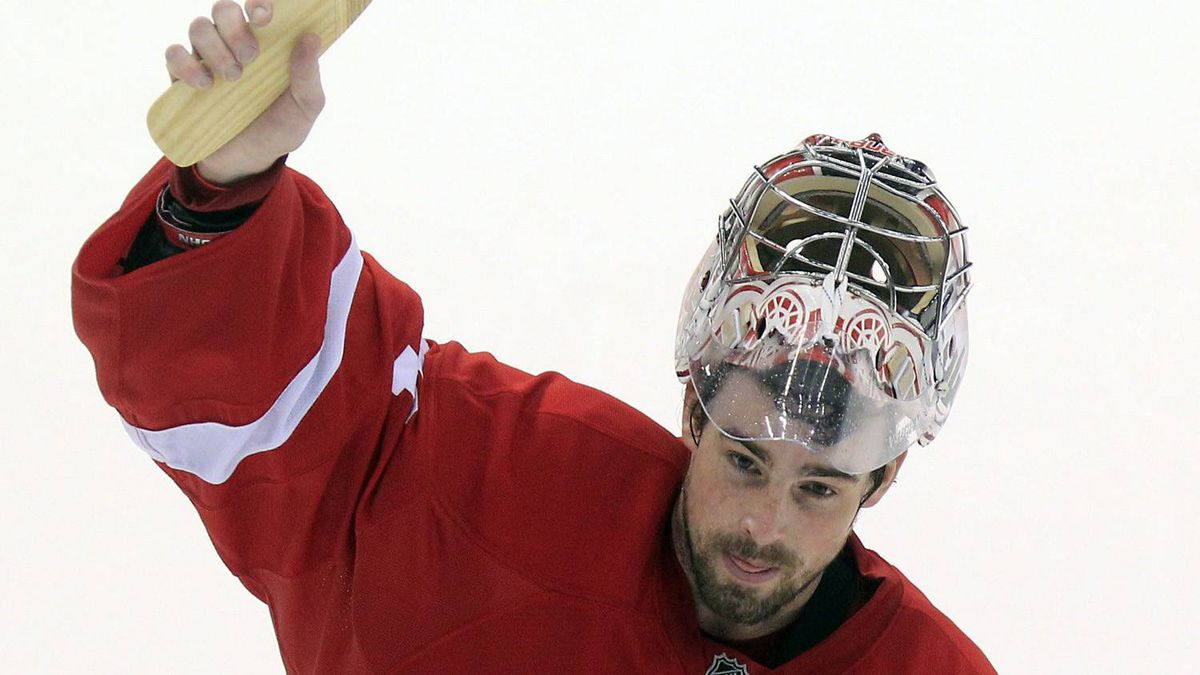 Detroit Red Wings goalie Joey MacDonald (31) acknowledges the crowd after a 3-2 win over the San Jose Sharks in an NHL hockey game in Detroit, Sunday, Feb. 19, 2012. The win extended the Wings' home consecutive streak to 23 games. (AP Photo/Carlos Osorio)