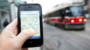 A GPS app is used on a mobile phone in front of a streetcar in downtown Toronto Wednesday, August 3, 2011.