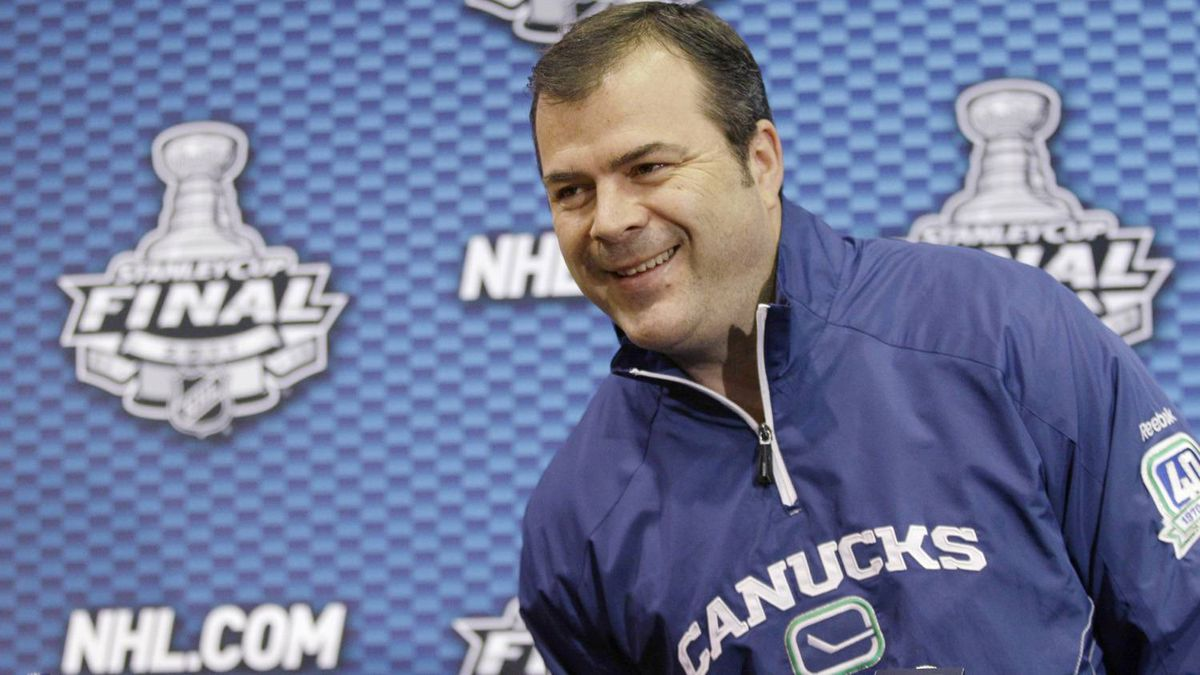 Vancouver Canucks head coach Alain Vigneault appears during a news conference, Tuesday, June 7, 2011, in Boston. The Canucks lead the Boston Bruins in the NHL Stanley Cup finals hockey series 2-1.