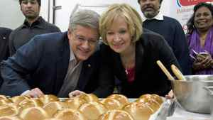 Conservative Leader Stephen Harper and his wife, Laureen, inspect a tray of hot cross buns at a bakery in Mississauga, Ont., on April 23, 2011.