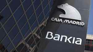A sign of Spain's Bankia bank is seen outside its headquarters in Madrid May 18, 2012.
