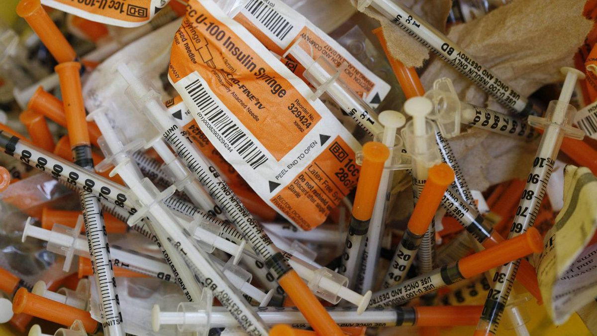 Used needles in a collection bucket at the AIDS Vancouver Island office along Johnson Street in Victoria, Nov. 25, 2010.