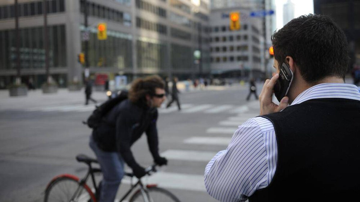 A man uses a cellphone in downtown Toronto in this file photo.