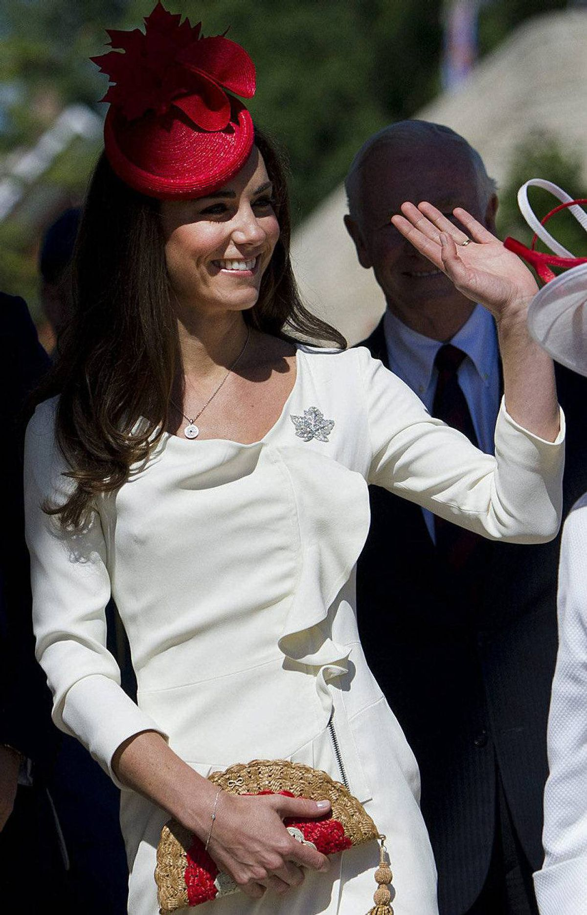 The Duchess of Cambridge waves to the crowd as she is accompanied by the Governor General's wife Sharon Johnston while arriving at the Museum of Civilization in Gatineau, Que., on Friday, July 1, 2011.